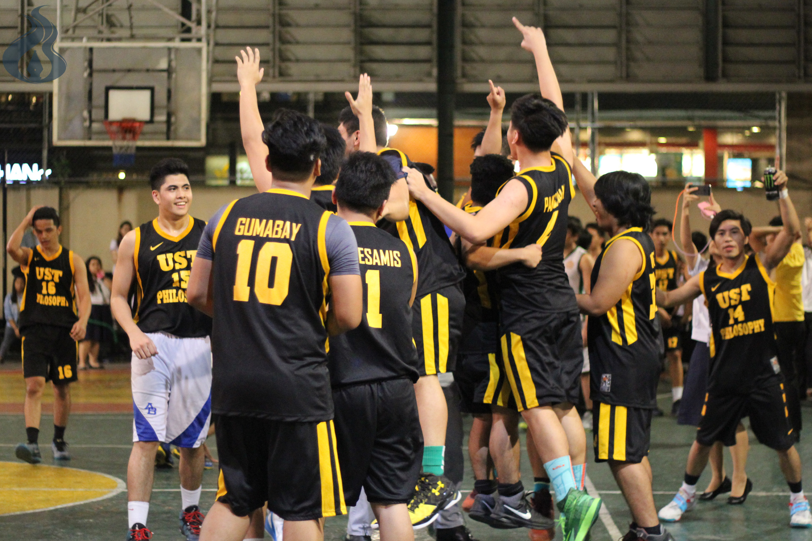 The team of Philosophy celebrates after wresting this year's AB Sportsfest basketball championship. photo by Maria Inna Franceska R. Lagazon